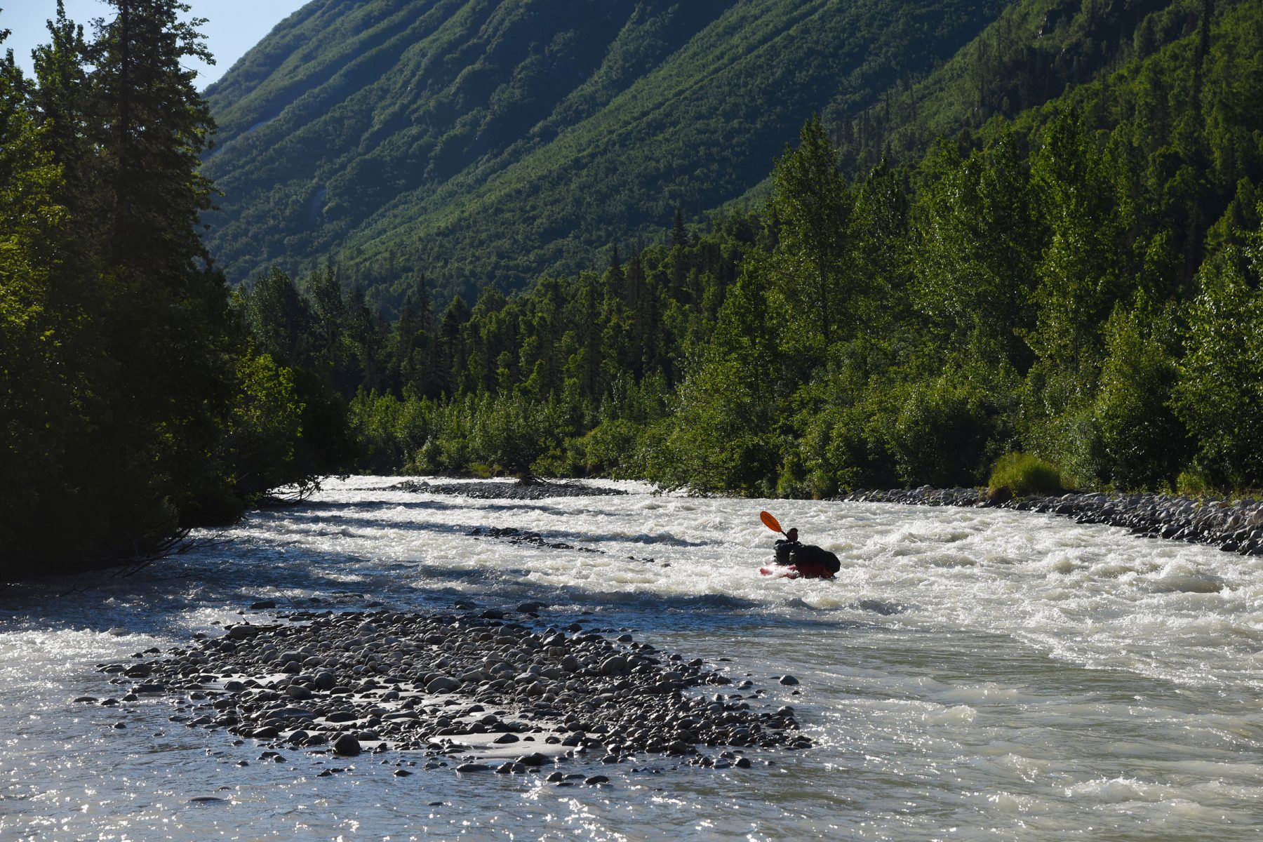 Brett Woelber packrafting the upper Kashwitna River