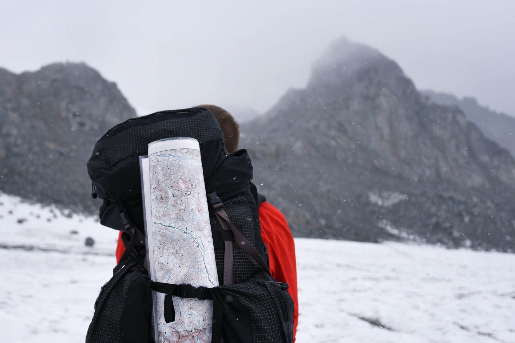 Tim Treuer carrying the Bomber Traverse Map in a backpack