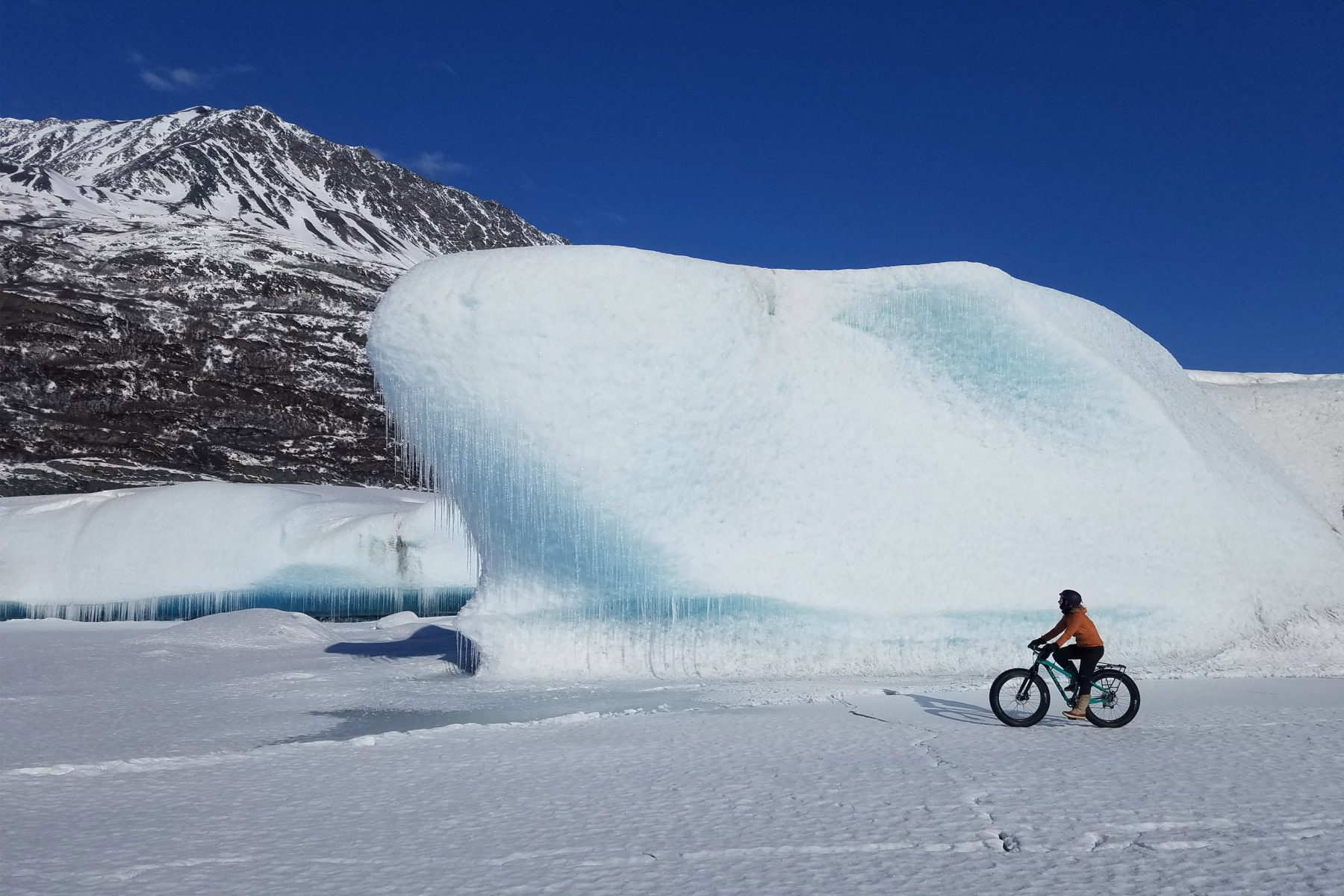 Devin Kelly fatbiking past Knik Glacier