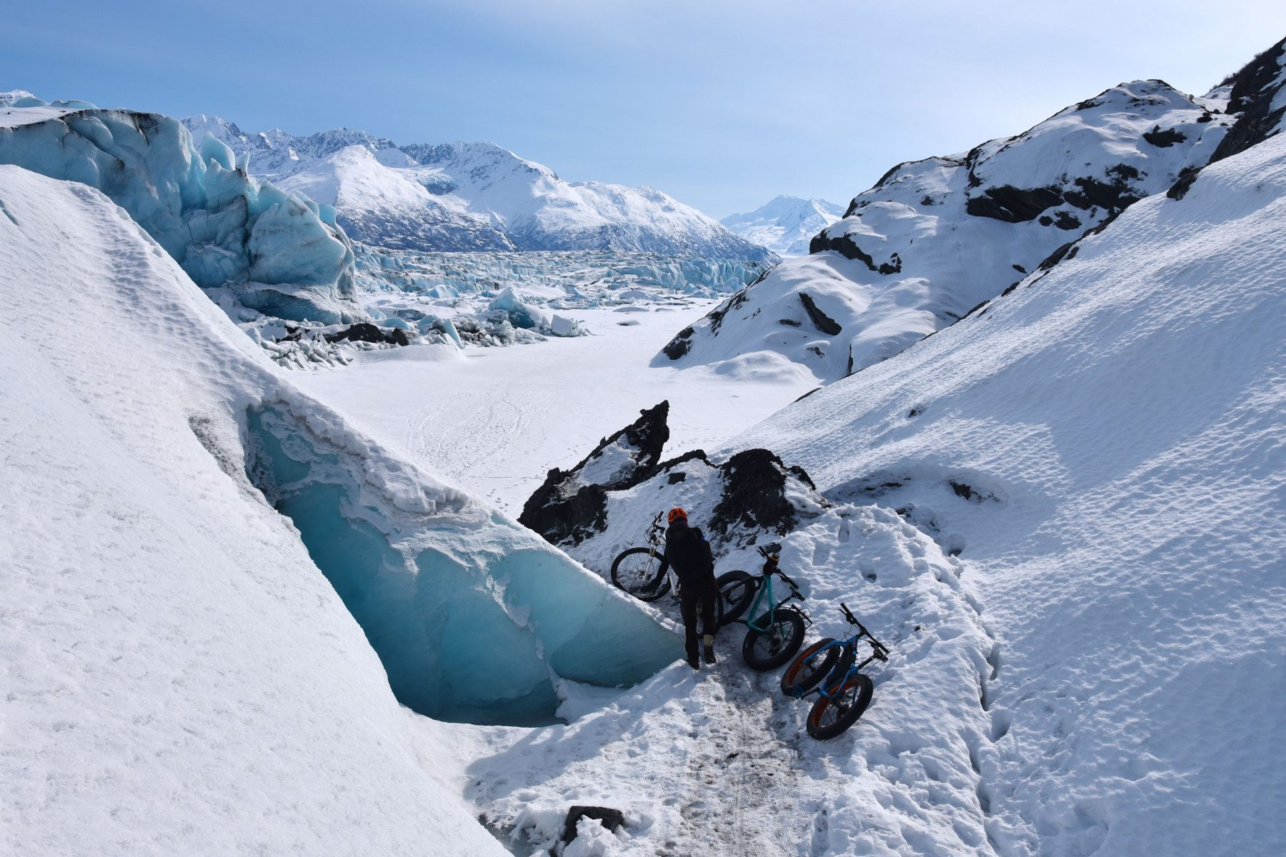 Shuttling bikes through a narrow part of the Knik Glacier Gorge
