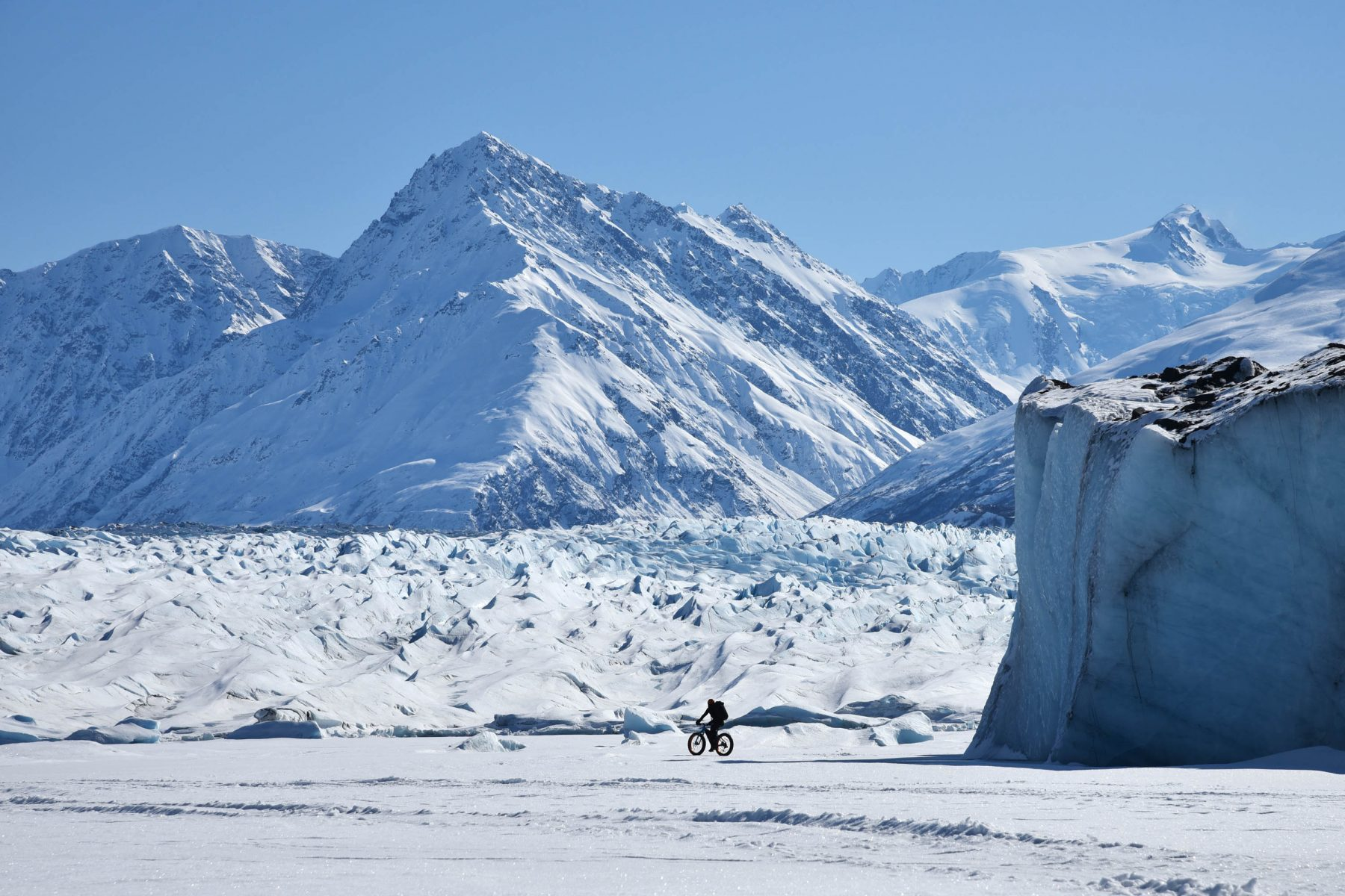 Cori riding around icebergs in the Knik Glacier lagoon