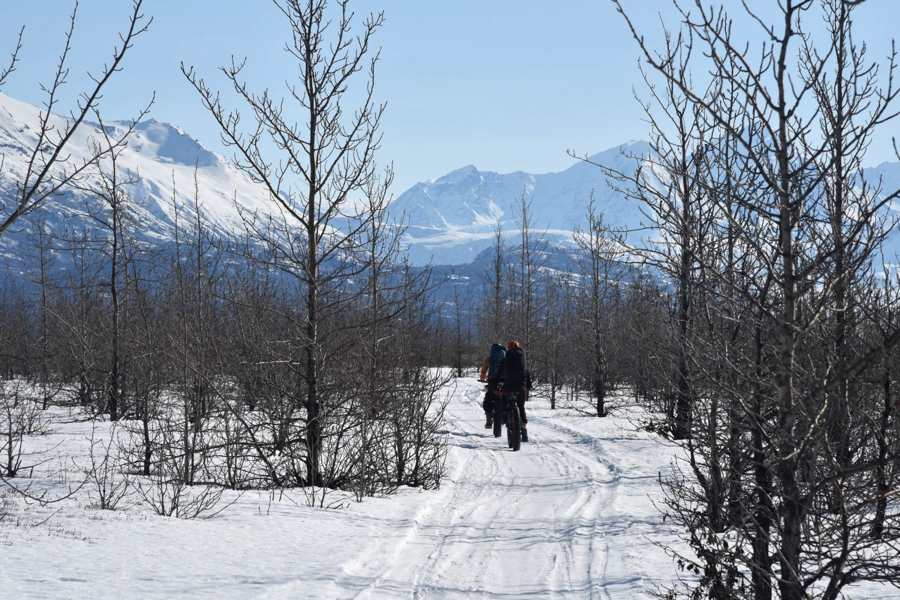 Cori Graves and Devin Kelly biking to Knik Glacier