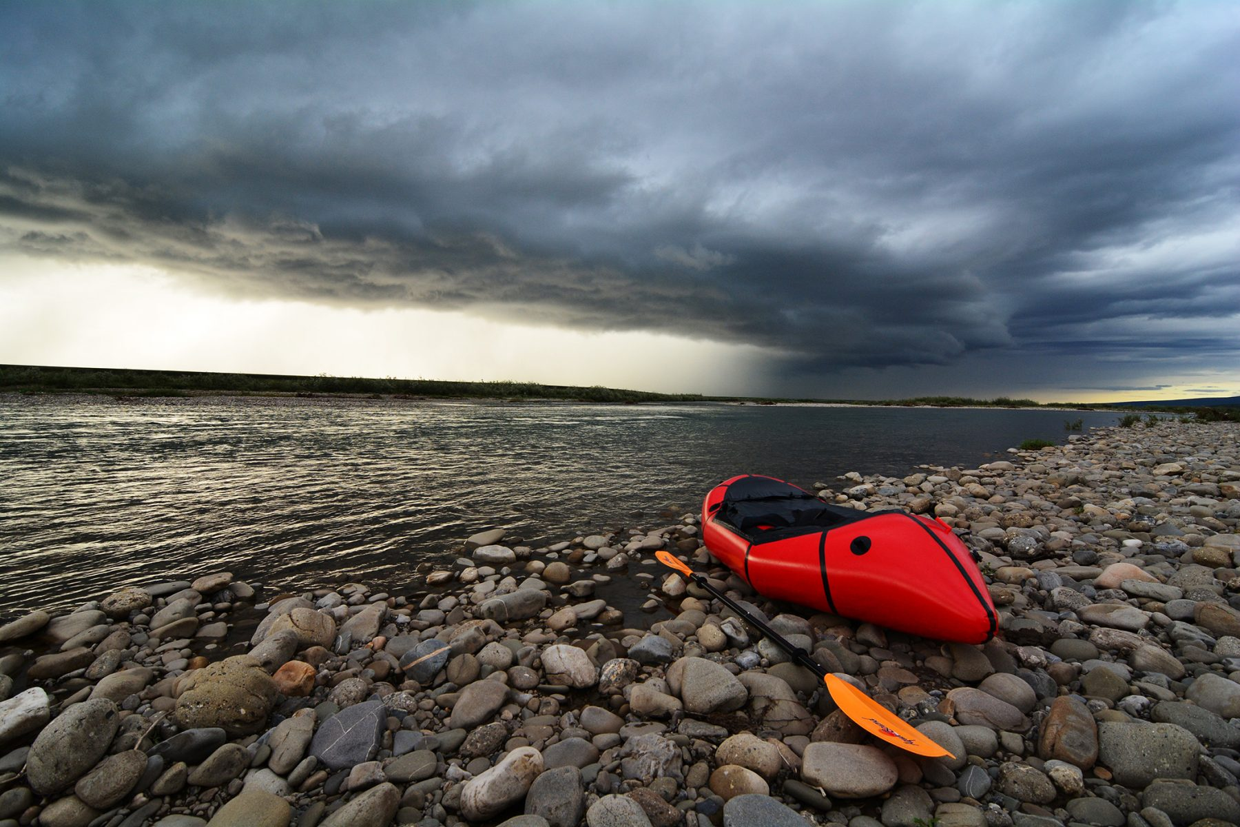 Alpacka packraft on the edge of the Anaktutuvk River