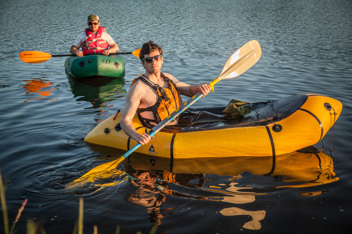 Paddling a packraft in Westchester Lagoon with two canoe paddles taped together