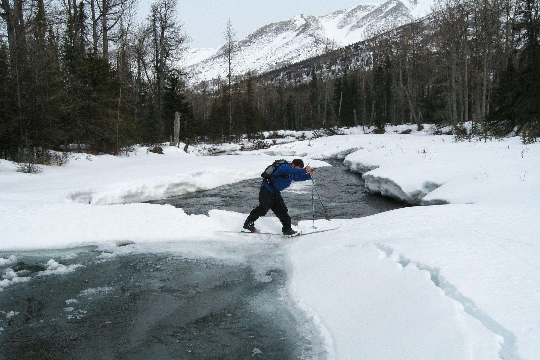 Brett Woelber crosses a snow bridge over Ship Creek, on the Arctic to Indian traverse